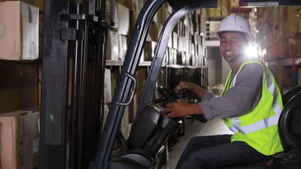 Forklift driver smiling at camera