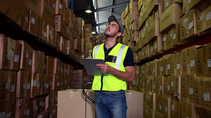 Warehouse worker checking his list