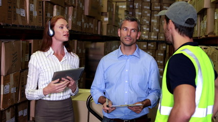 Warehouse worker talking with management