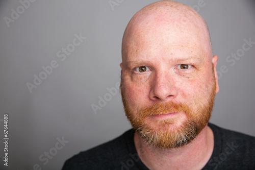 Crazy eyed bald man with a beard