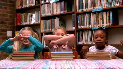 Cute little girls posing with library books