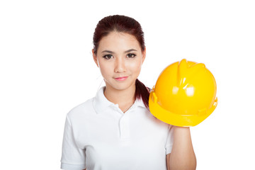 Asian engineer girl hold a hardhat and smile