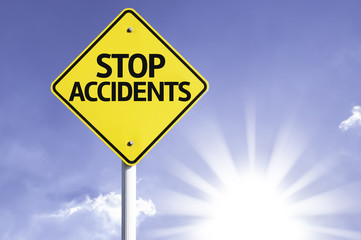 Stop Accidents road sign with sun background