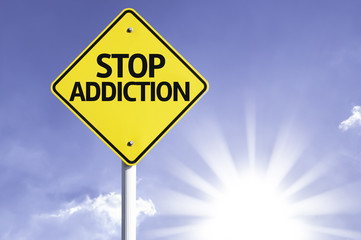 Stop Addiction road sign with sun background