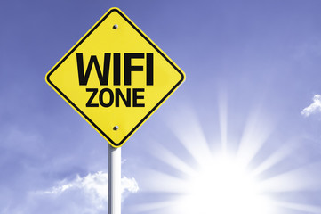 WIFI Zone road sign with sun background