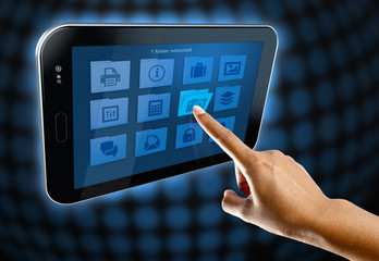 a woman's finger, selects a folder on a tablet screen