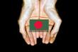 Flag of Bangladesh in hands on black background