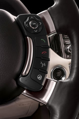 Car interior. Detail of some buttons on steering wheel.