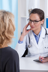 Lady doctor discuss with the patient