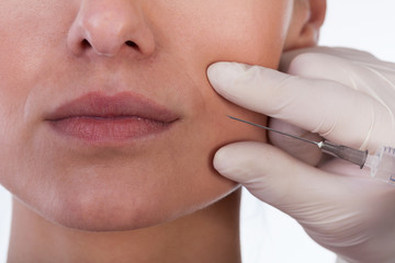 Woman receiving plastic surgery injection