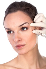 The doctor injects liquid wrinkle preventive woman