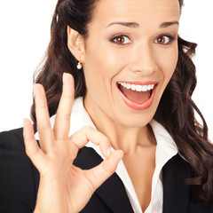 Business woman with okay gesture, on white