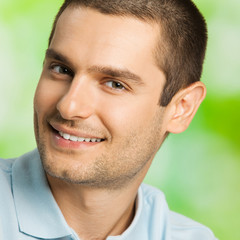 Portrait of happy young man, outdoors