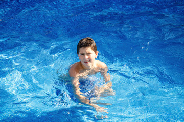 Boy in the swimming pool