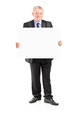 Mature businessman holding a blank poster