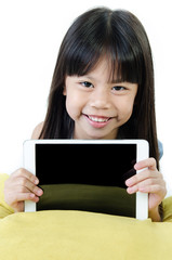 Little asian girl smiles with tablet computer