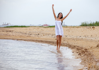 woman happy excited smile on beach
