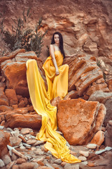 sensual girl on the rocks