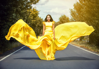 girl in a yellow dress on road