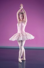 Graceful ballerina standing in fifth position