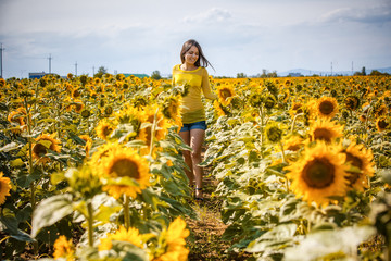 rural girl in field sunflowers