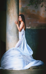 fine young girl with a light dress. Romance style