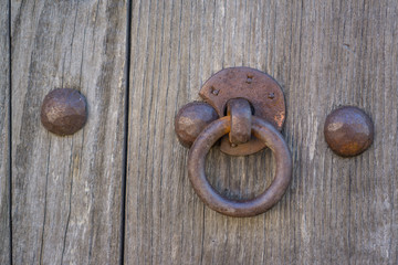 Old doorknocker and door