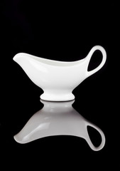 Empty white ceramic mug isolated on black background