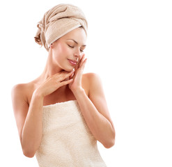 Spa Woman. Beautiful Girl After Bath Touching Her Face. Skincare