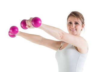 Smiling young woman with dumbbells