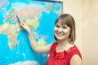 Woman shows something on the worldmap