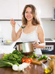 Ordinary long-haired  woman cooking  soup