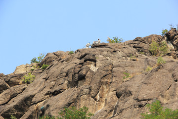 Climbers at the top of the rock , ready for downhill