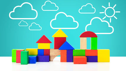 Building blocks toy over floor with cloud and sun background