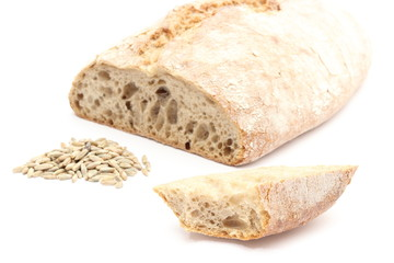 Slice and loaf bread with heap of rye grain