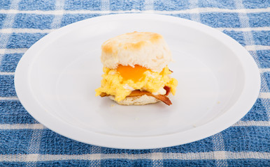 Scrambled Eggs and Bacon with Cheese on Biscuit