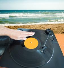 DJ mixing beach