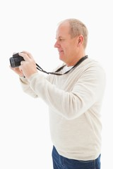 Happy mature man taking a picture