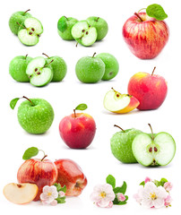 Red and green apples with leaves and water drops on a white back