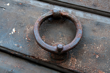 Old doorknob in the form of a steel ring
