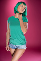 Beautiful slender woman with turquoise hair