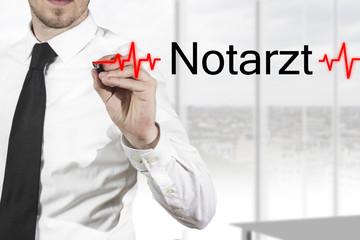 Arzt schreibt Notarzt in die Luft
