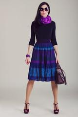 Fashion magazine shoot. Girl in fashionable clothes