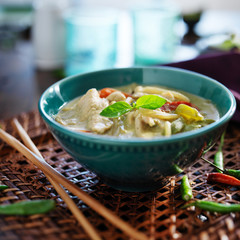 thai green curry with chicken in bowl