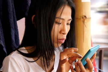 Asian Lady with Mobile Phone