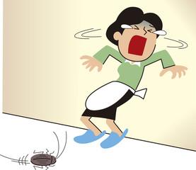 ゴキブリを恐れる女性