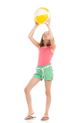 Girl playing beach ball