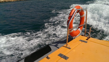 Fast trip on the rescue boat, railings and ring buoy