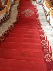 stair covered with red carpet