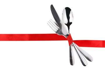 Fork, spoon and knife tied with a red ribbon